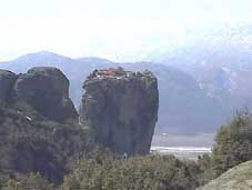 Note the monastery on top of the centre rock in Meteora