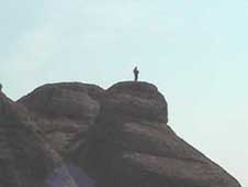 Brave person on top of the rocks at Meteora